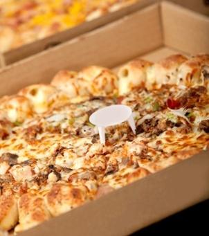Delicious provocative pizza in a cardboard box.jpeg