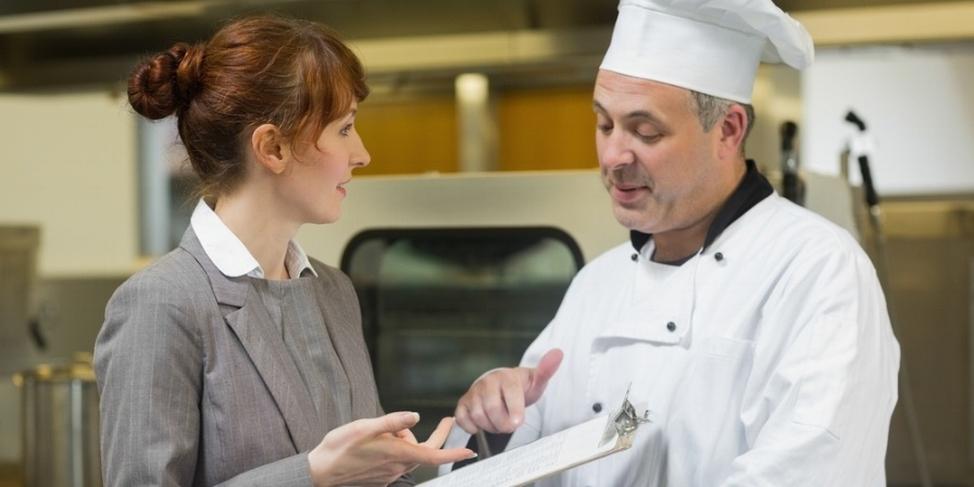 Young female manager talking to the head cook standing in a professional kitchen-875134-edited.jpeg
